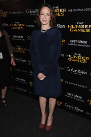 Nina Jacobson wore this long-sleeve navy silk dress to the NY screening of 'The Hunger Games.'