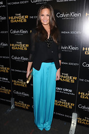 Chrissy Teigen looked sleek (and comfy!) in these aqua silk pants at the NY screening of 'The Hunger Games.'