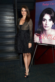 Penelope Cruz went the frilly route in a feather-embellished cocktail dress by Michael Kors at the screening of 'Ma ma.'