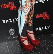 Zosia Mamet gave herself a boost in a pair of towering, red T-strap platform pumps.