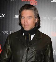Anson Mount is a believer of the power of scarves to add polish to any outfit, tucking it into a jacket lends the outfit a more formal feel too.