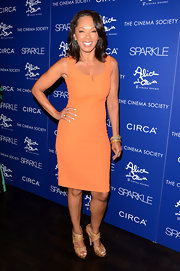 Debra looked simply brilliant in this tangerine sheath dress at the 'Sparkle' premiere in NYC.