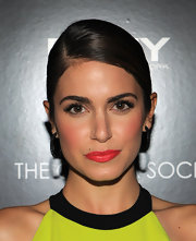 Nikki Reed wore a vibrant tangerine lipstick at a screening of 'The Twilight Saga: Breaking Dawn Part 1.'