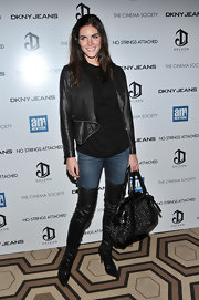 Hilary Rhoda teamed her jacket with a studded black Burberry tote and thigh-high boots for total edge.
