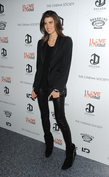 Michelle looked sleek and stylish in a black satin trimmed blazer and leather leggings.