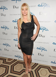 Genevieve Morton went for a sultry look with a figure-hugging cowl-neck LBD at the screening of 'The Adopted.'