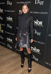 A pair of knee-high black cutout boots added major edge to Genevieve Jones' ensemble.