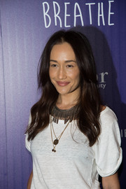 Maggie Q styled her simple tee with a tribal-inpsired chain necklace along with some pendants.