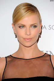 Charlize Theron wore a pair of old European cut diamond drop earrings at a screening of 'Young Adults.