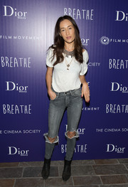 Maggie Q completed her edgy-casual look with a pair of black ankle boots.