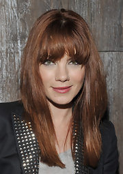 Michelle Monaghan went a little rocker-chick at a screening for 'Restless'. Her long, lash-length bangs were brushed forward and the rest of her tresses were straightened with a flat iron.