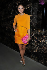 Olivia Palermo added feminine flair to her Mandarin dress with a pink satin Rose box clutch.