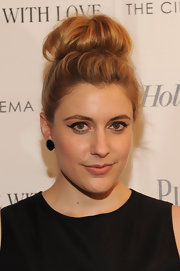 Greta Gerwig capped off her look with a fun top-knot when she attended the screening of 'To Rome with Love.'