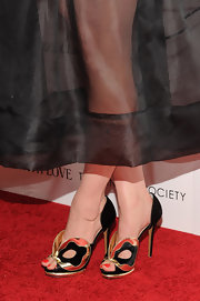 Greta Gerwig's fab black and gold cutout evening sandals were the highlight of her look during the screening of 'To Rome with Love.'