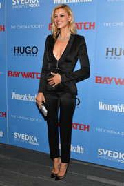 Kelly Rohrbach teamed her suit with black lace cap-toe pumps by Jimmy Choo.