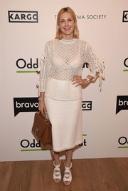 Kelly Rutherford paired her top with a white tweed pencil skirt.