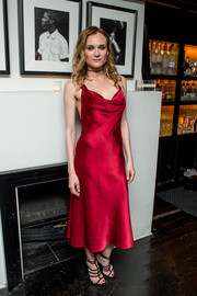 Diane Kruger brought plenty of allure to the premiere of 'Sky' with this red-hot cowl-neck dress by Cushnie Et Ochs.