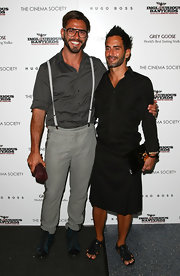 Marc paired his black kilt with a pair of black leather sandals.