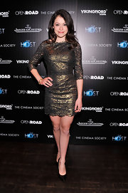 Tatiana Maslany chose a metallic gold and black dress with a feminine scalloped hem for her red carpet look.