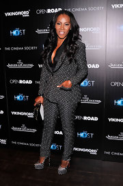 June Ambrose chose this checkered pantsuit for her fun and quirky red carpet look at 'The Host' NYC screening.