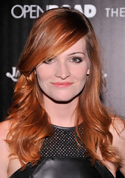 Raeden Greer's fiery red hair looked soft and shiny when styled into loose waves with straight side bangs.