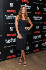 Kelly Bensimon pulled her look together with simple black ankle-strap sandals.