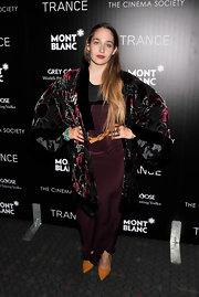 Our favorite boho girl Jemima Kirke wore this eggplant maxi dress for a totally retro-inspired look.