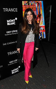 A long black trench was a subtle touch to Gretta Monahan's evening look at the 'Trance' premiere in NYC.
