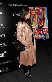 Gina Gershon complemented her metallic coat with a quilted black leather bag for a chic finish at the 'Trance' premiere.