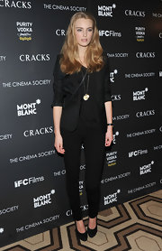 Ymre wears skinny black pants with her dramatic dark ensemble at the premiere of 'Cracks.'