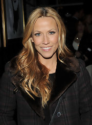 Singer Sheryl Cole parted her long curls down the center at the screening of 'Meek's Cutoff'.
