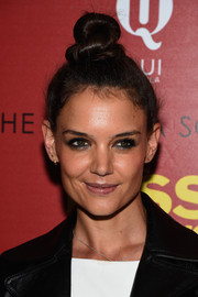 Katie Holmes went for a bold smoky eye while playing down her lips.