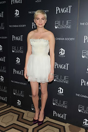 Michelle Williams added a pop of color to a floaty Dior dress with purple Paloma platforms.