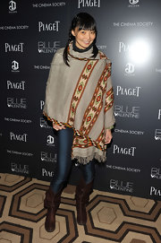 Irina wore a poncho inspired wool shawl for this laid back red carpet style.