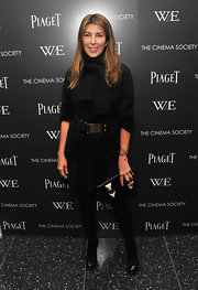Nina Garcia added oomph to her monochromatic premiere look with a black leather clutch featuring oversize gold studs.