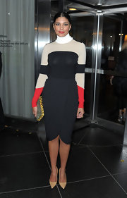 Rachel Roy gave her color-block turtleneck a classic finish with a black tulip-cut pencil skirt.