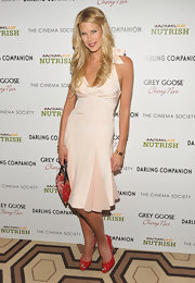Beth Ostrosky-Stern attended a screening of 'Darling Companion' wearing a sexy pair of red peep toe pumps.
