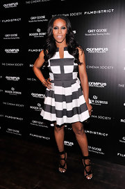 June Ambrose kept her look edgy and modern with this black and white striped mini dress with pleated skirt.