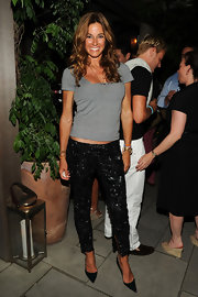 Kelly paired her basic grey t-shirt with black sequin pants.
