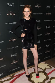 Kristen paired her Roland Mouret dress with patent, platform pumps.