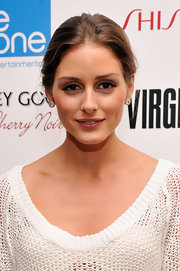Olivia Palermo wore her hair casually pulled back when attending a screening of 'Virginia.'