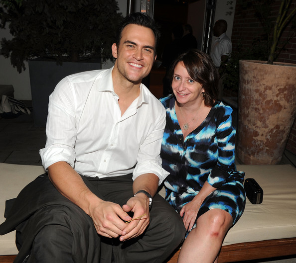 Cheyenne Jackson rolled up the sleeves of his white button-down shirt for a laid-back look.