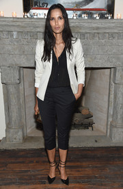For her shoes, Padma Lakshmi chose a pair of black pumps with triple ankle straps.