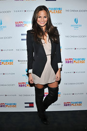 Christine Teigen wore a crisp black blazer over her loose frock for the screening of 'happythankyoumoreplease.'
