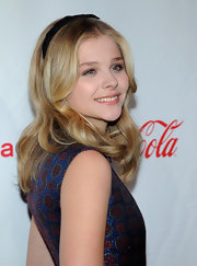 Chloe Grace Moretz looked lovely with her hair in long smooth waves and wearing an adorable velvet headband.