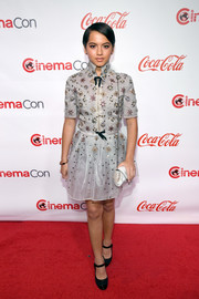 Isabela Moner looked adorably glam in a beaded silver shirtdress by Reem Acra at the CinemaCon Big Screen Achievement Awards.