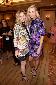 Kirsten Dunst exuded feminine appeal wearing this floral frock by Gucci during CinemaCon 2017.