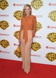 Katherine Heigl was classic in a burnt-orange tie-neck blouse by Chloe at the CinemaCon 2017 Warner Bros. Pictures presentation.