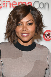Taraji P. Henson looked tres cool with her asymmetrical wavy bob at CinemaCon 2018.
