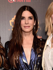 Sandra Bullock rocked a messy center-parted hairstyle at CinemaCon 2018.
